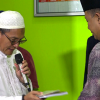 ICM Menyerahkan Sumbangan buku Agama Islam ke Pemda Koltim